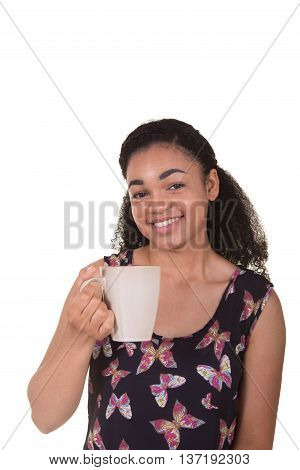 A young woman holding a hot drink in a mug