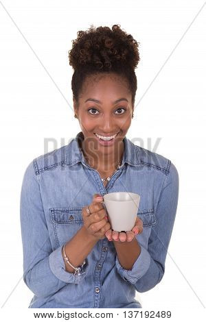 A young woman holding a cup of coffee or tea isolated on white