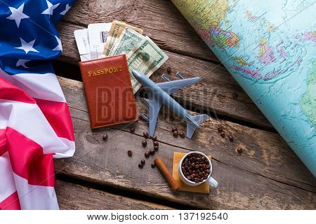 Passport near USA flag. Dollars and coffee beans. Take a trip to America. Freedom of law-abiding citizen.