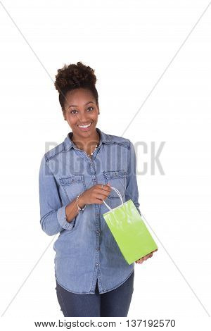 A young woman with shopping bags isolated on white
