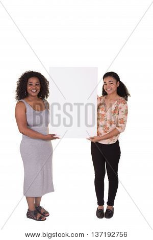 2 young women or college students holding a poster board for an advertisement