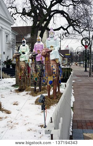 PLAINFIELD, ILLINOIS / UNITED STATES -DECEMBER 29, 2015: The Three Wise Men ride their camels in a nativity scene standing outside of the Plymouth Congregational Church in downtown Plainfield.