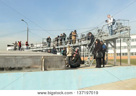 MOSCOW - MAR 19, 2015: Reporters and visitors near receiving chamber, closed glass, water comes here straight from sewer, Kuryanovskaya aeration station, tour