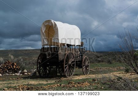Western covered chuckwagon for cooking food on the trail with storm approaching