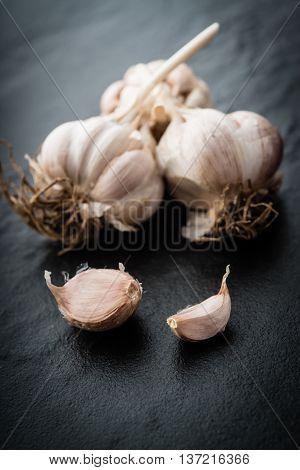 Garlic. Fresh Garlic. Cloves of garlic on black background.