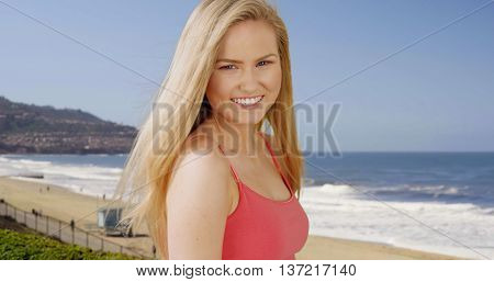 Happy Young Adult Woman Standing On Southern California Beach