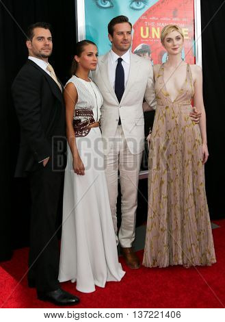 NEW YORK-AUG 10: (L-R) Actors Henry Cavill, Alicia Vikander, Armie Hammer and Elizabeth Debicki attend