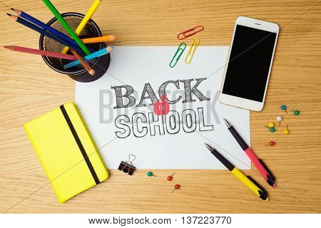 Back to school concept with white paper and school supplies. Top view