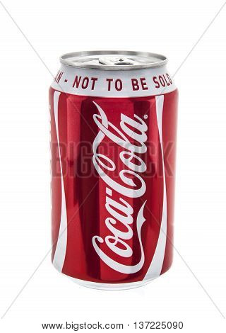 SWINDON UK - JANUARY 10 2014: Coca-Cola multi pack can on a white background Coca-Cola is a carbonated soft drink sold in stores restaurants and vending machines throughout the world.