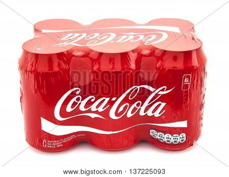 SWINDON UK - JANUARY 10 2014: Coca-Cola multi pack on a white background Coca-Cola is a carbonated soft drink sold in stores restaurants and vending machines throughout the world.