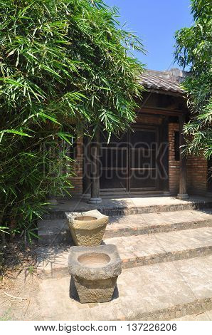 Old gate in front of an antique house in the countryside of Vietnam