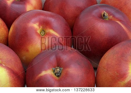 a few nectarines lying next to each other