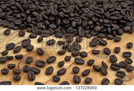 coffee beans spill on the pine boards