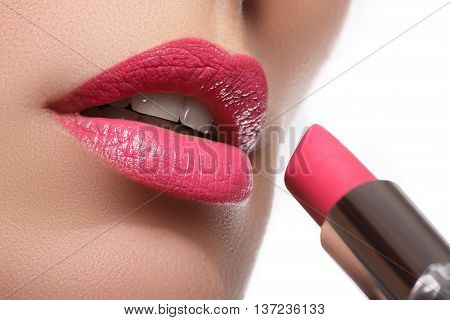 Beautiful full pink lips. Lipstick. Professional make-up. Beauty woman with perfect make-up. Pink lips. Close-up portrait of young lady