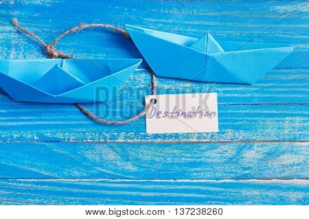 Paper Boat With A Sign Destination - Travel Concept