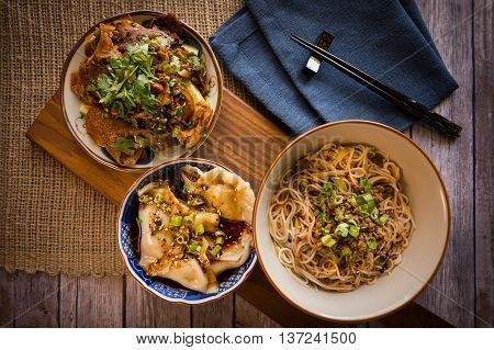 Traditional Chinese bowl of wanton noodle with pork and beef on the table