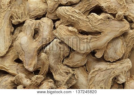 Organic dry Ginger root or Sonth (Zingiber officinale). Macro close up background texture. Top view.