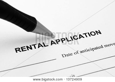 Close up of pen on rental application poster