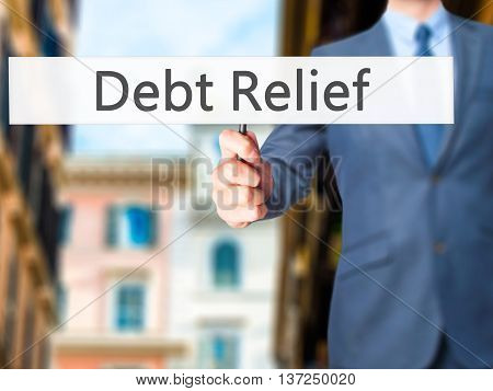 Debt Relief - Businessman Hand Holding Sign