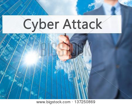 Cyber Attack - Businessman Hand Holding Sign