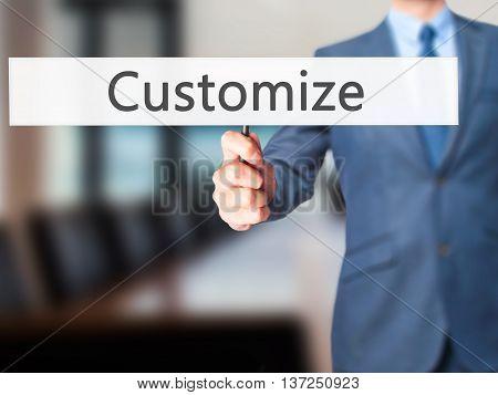Customize - Businessman Hand Holding Sign