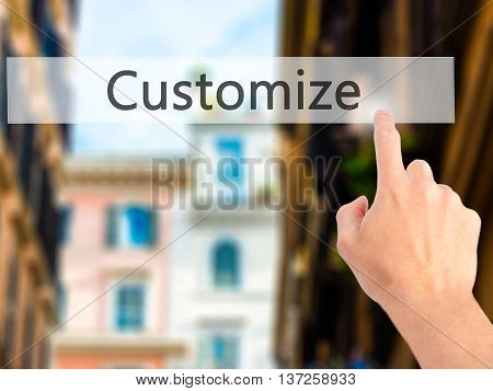 Customize - Hand Pressing A Button On Blurred Background Concept On Visual Screen.