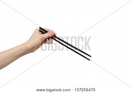 left hand holding chopsticks on white background.