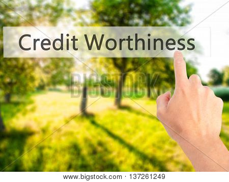 Credit Worthiness - Hand Pressing A Button On Blurred Background Concept On Visual Screen.