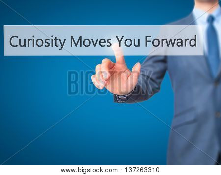 Curiosity Moves You Forward - Businessman Hand Pushing Button On Touch Screen