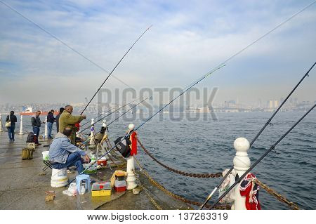 Istanbul Turkey - November 9 2014: Istanbul at the Bosphorus bonito bluefish mackerel sardines sea bass and other bottom fish hunt. Migration time increases in fishing catch fish.