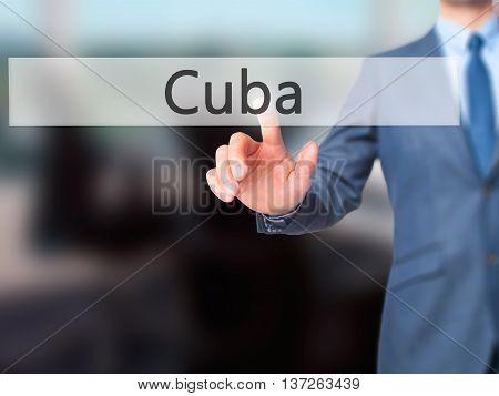 Cuba - Businessman Hand Pushing Button On Touch Screen