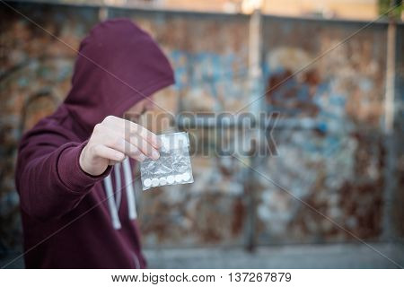 Pusher and drug addict exchanging money with drug