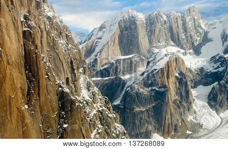 Rocks in the mountains. Snow crevices. Nature.