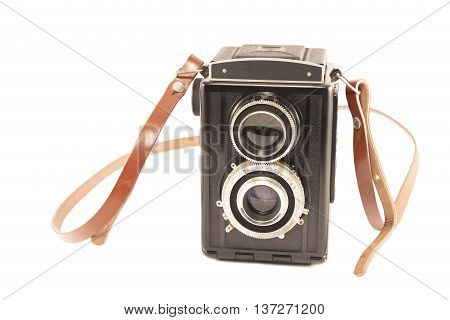 Vintage camera with the leather strap isolated