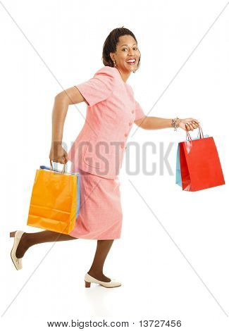 African-american female shopper running from one store to another for bargains.  Isolated on white.