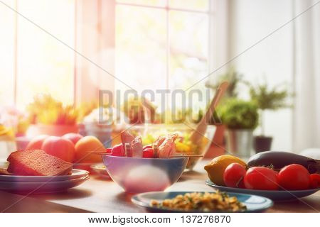 balanced diet, cooking, culinary and food concept. food for a family dinner on a wooden table in the dining room. poster