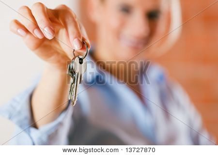 Realtor is giving the keys to an apartment to some clients � focus on the keys