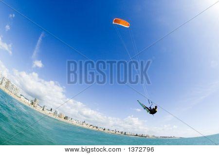 Kite Surfer On Turquoise Paradisaic Water