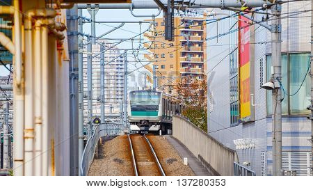 TOKYO JAPAN - NOVEMBER 29 2015: A local train arrives at Ikebukuro station