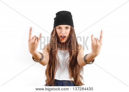 Cool young girl in hat showing sign of the horns