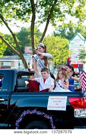 SOUTH ST. PAUL, MINNESOTA - JUNE 24, 2016: Mrs. Minnesota waves to crowd from motorcade at annual South St. Paul Kaposia Days Grande Parade on June 24.
