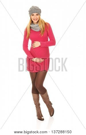 Happy pregnant woman in outerwear