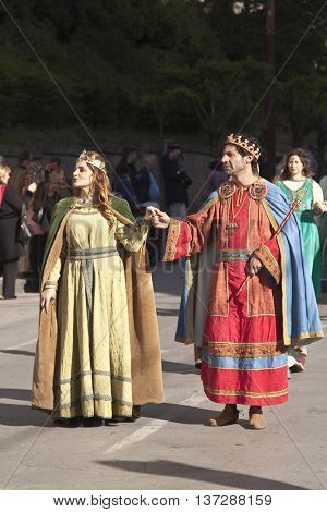Enna, Italy - May 2016: People dressed as a King and Queen take part in the medieval costume parade along the street. Tenth Edition of Historical Parade, 15 may 2016, Enna, Sicily