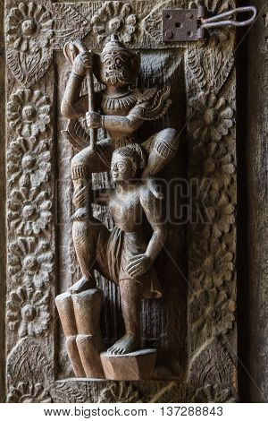 Antique wood carving in the form of deities in the ancient temple in Burma Myanmar