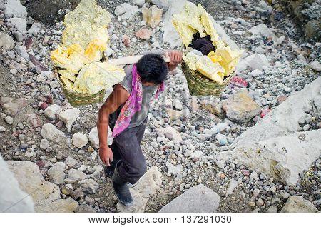 Worker Carries Sulfur Inside Crater Ijen Volcano, Indonesia