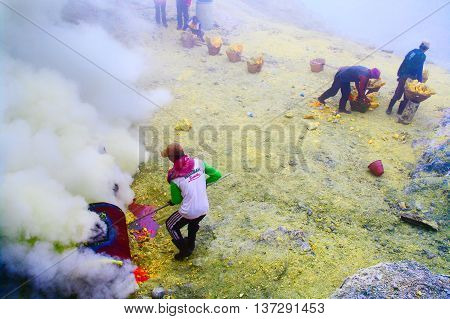 IJEN VOLCANO INDONESIA - JAN 10 : Workers extracting sulfur inside crater in Ijen Volcano on January 10 2011 in East Java Indonesia.