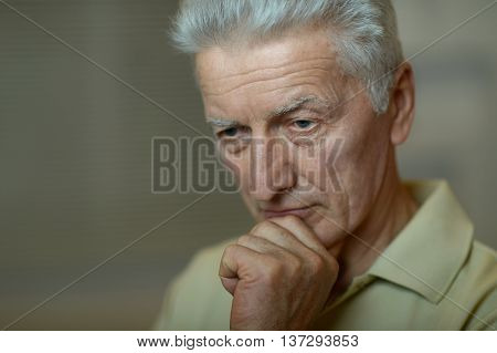 Portrait of a sad senior man face