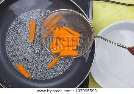 Chef scald carrot with hot water / cooking steak concept