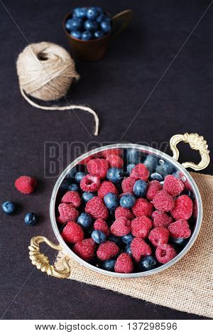 Fresh Raspberries And Blueberries Dark Picture. Fresh Fruits, Berries In An Old Copper Cup, Bowl. Da