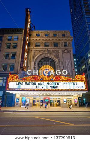 CHICAGO, IL - CIRCA MARCH, 2016: facade of Chicago Theatre at night time. The Chicago Theatre is a landmark theater located on North State Street in the Loop area of Chicago, Illinois.